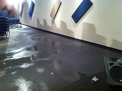 A burst water pipe causes extensive carpet water damage to a church.